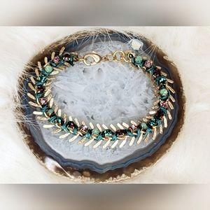 Goldtone and rhinestone wrap bracelet